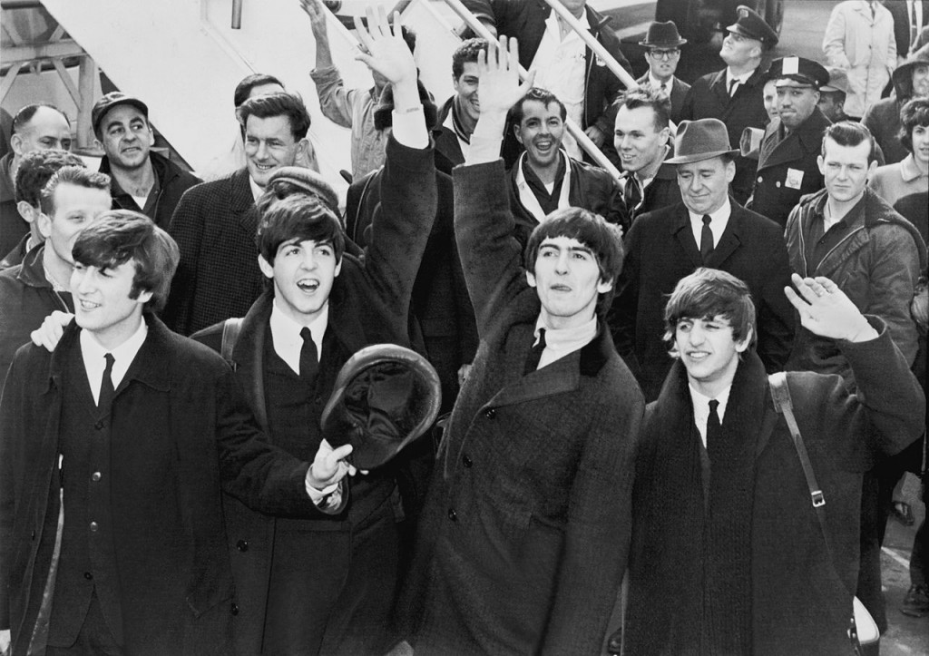 The Beatles – John Lennon, left, Paul McCartney, George Harrison, and Ringo Starr – arrive at JFK Airport on Feb. 7, 1964 for the band's first appearance in the United States. Photo courtesy the U.S. Library of Congress