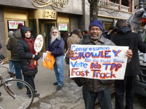 Protesters at U.S. Rep. Joe Crowley's office said a controversial trade deal could potentially ship domestic jobs overseas and undermine laws protecting public health, workers' rights and the environment. Photo by Phil Corso
