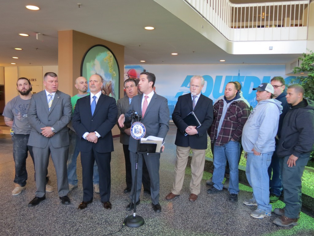 Assemblyman Phil Goldfeder, center, joins union officials and civic leaders on Monday to announce a bill he is sponsoring to bring millions of dollars to Aqueduct for capital projects.  Photo by Anna Gustafson
