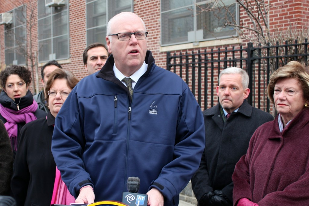 U.S. Rep. Joe Crowley, center, joined Assemblywoman Cathy Nolan, behind left, state Sen. Michael Gianaris, Councilman Jimmy Van Bramer, and Assemblywoman Marge Markey Tuesday to denounce the city's plan to bus students from PS 11 to the other end of the school district while the facility is undergoing renovations. Photo courtesy U.S. Rep. Joe Crowley's office