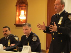 Deputy Inspector Henry Sautner, commanding officer of the 102nd Precinct, standing right; David Barrere, the new commanding officer of Patrol Borough Queens South, center; and Deputy Inspector Jeffrey Schiff, commanding officer of the 106th Precinct, attend a forum on domestic violence last week. Photo by Anna Gustafson
