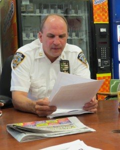 Police from the 104th Precinct urged residents, especially women, to be extra vigilant following a series of knifepoint robberies. Residents who have concerns about crime in the area can meet Capt. Christopher Manson, pictured here, at the next 104th Precinct Community Council meeting on March 18. File photo