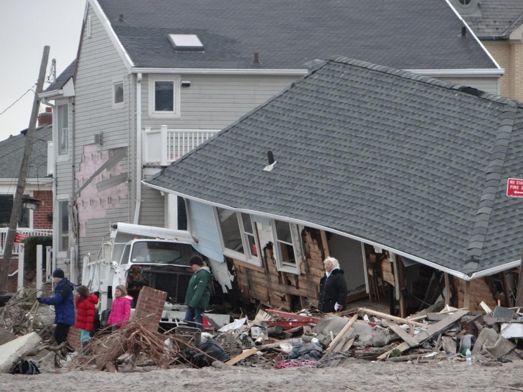 A collapsed home in Breezy Point after Hurricane Sandy. Photo by Richard York