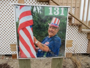 Harold Peters, a residents of Beach 131st Street in Belle Harbor for decades, would raise an American flag on his street every day for 30 years - a move that is emblematic of the kind of dedication residents said people have to the neighborhood. Such commitment, they said, has inspired them to keep fighting for their area after Hurricane Sandy devastated it - and now that the city has left them feeling abandoned.  Photo by Anna Gustafson