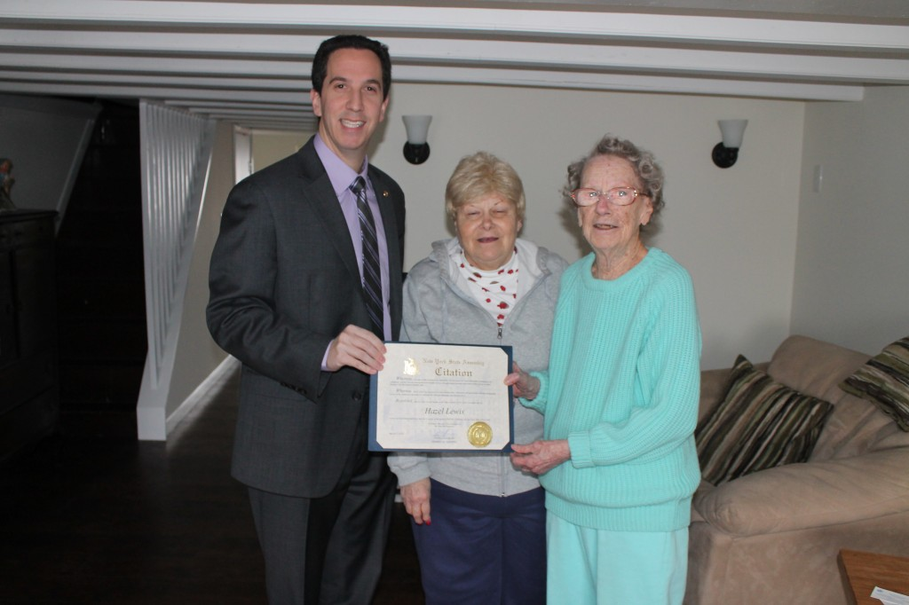Broad Channel resident Hazel Lewis, right, was presented with a citation honoring her 100th birthday this week from Assemblyman Phil Goldfeder. Lewis, a Broad Channel resident for 50 years, celebrates here with the legislator and her neighbor, Arlene Nix.