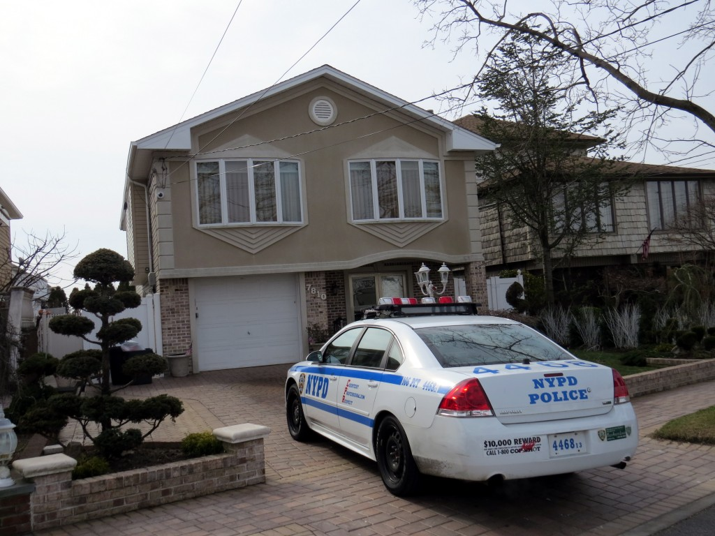 Police investigate a home invasion in Howard Beach last week.