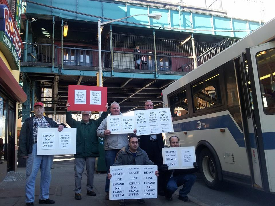 David Quintana, left, Stanley Schulman, Marty Ingram, Ron Carroll, Phil McManus, and Mike Scala rally at Jamaica Avenue in support of the Rockaway Beach Rail Line last Sunday. Photo courtesy David Quintana