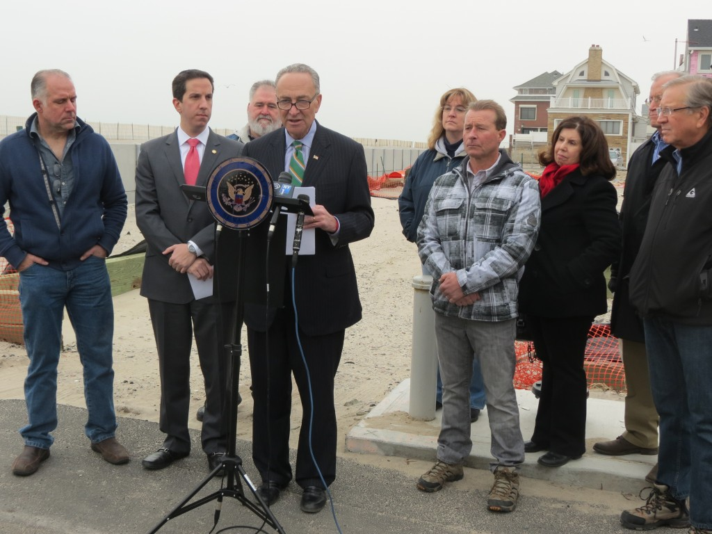 U.S. Sen. Chuck Schumer, center, Assemblyman Phil Goldfeder, second from left, and South Queens and Rockaway civic leaders gathered in Belle Harbor Monday to urge the U.S. Senate to pass legislation that aims to keep flood insurance rates affordable. Photo by Anna Gustafson