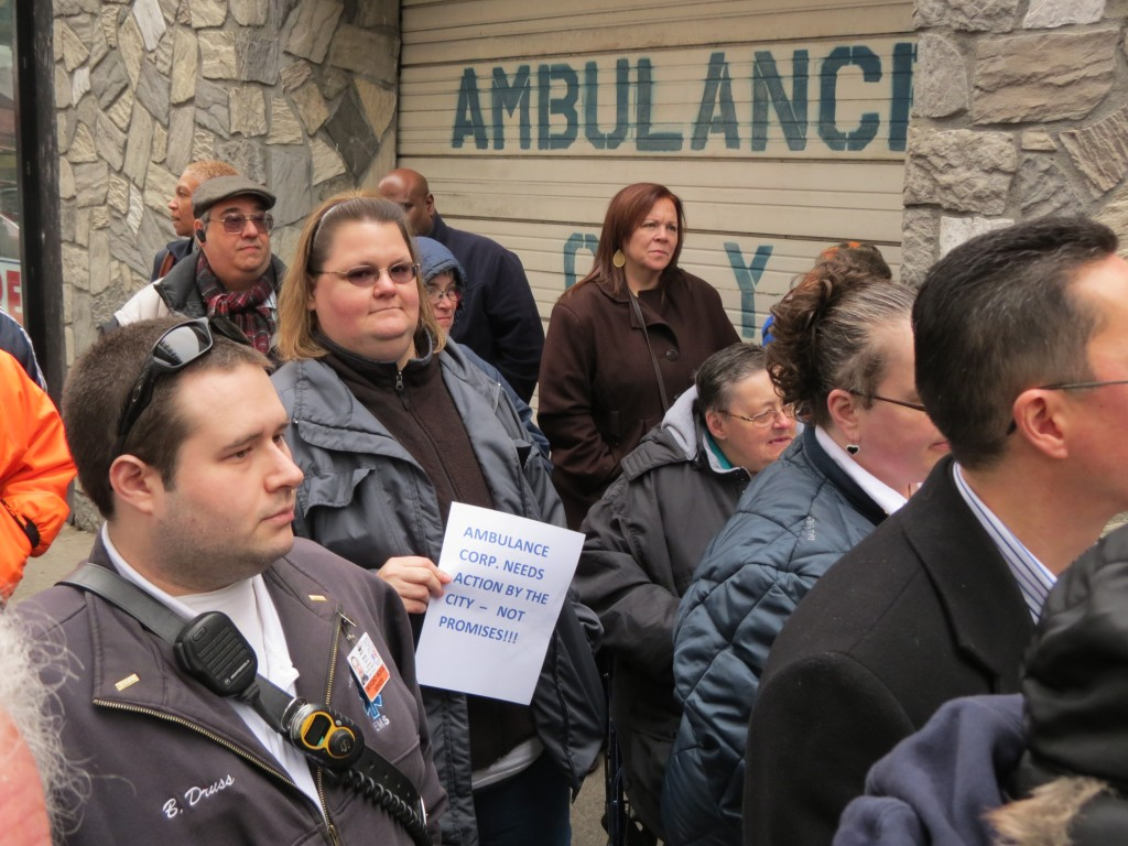 Residents, civic leaders, and elected officials attended a rally Sunday to urge the city to tear down a building that partially collapsed in April.  Photo by Anna Gustafson