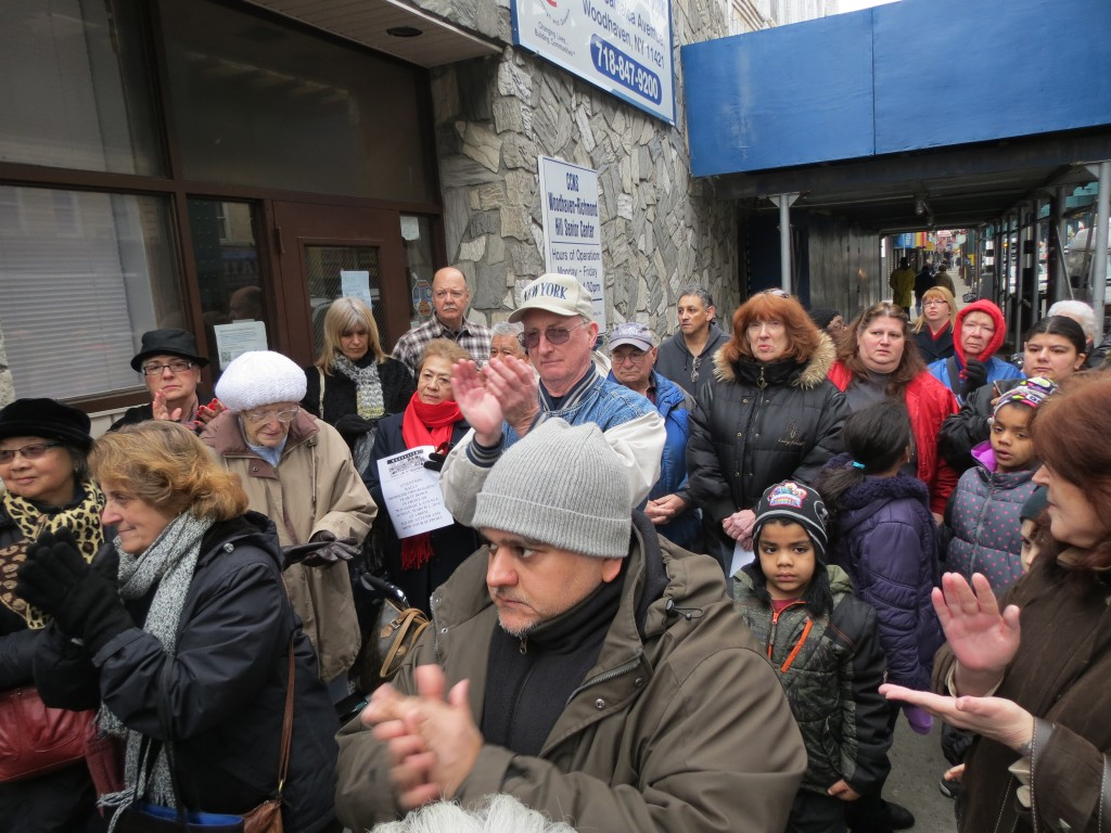 A building that partially collapsed in Woodhaven last April is becoming increasingly dangerous to the community and must be torn down before tragedy strikes, civic leaders and residents said at a rally held Sunday.  Photo by Anna Gustafson