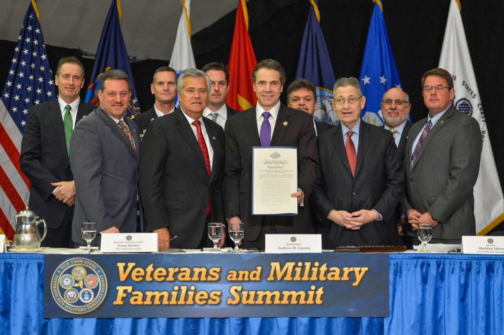 Gov. Andrew Cuomo, center, and other elected officials, including state Sen. Joe Addabbo Jr., front left, participated in a summit for veterans and military families last week. Photo courtesy Gov. Andrew Cuomo's Office