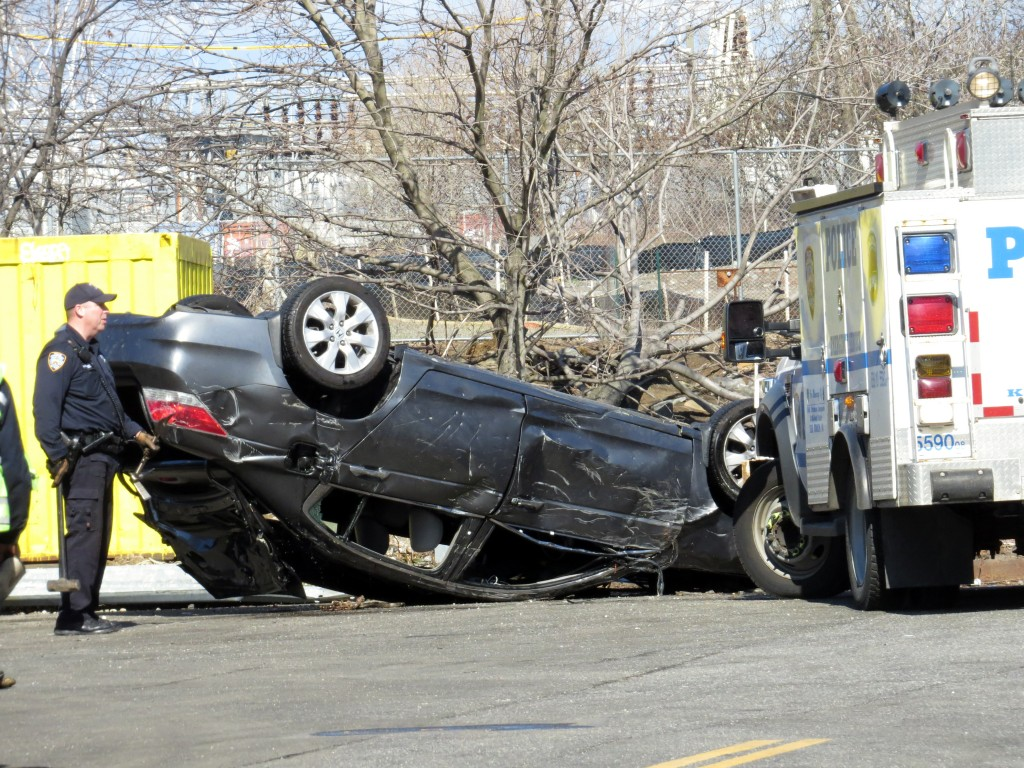 Four people died after this car flipped over into Steinway Creek in Astoria Friday. Photo by Robert Stridiron