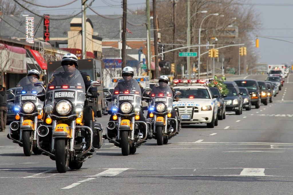 The funeral procession for Officer Dennis Guerra travels down Cross Bay Boulevard in Howard Beach. Photo by Richard York