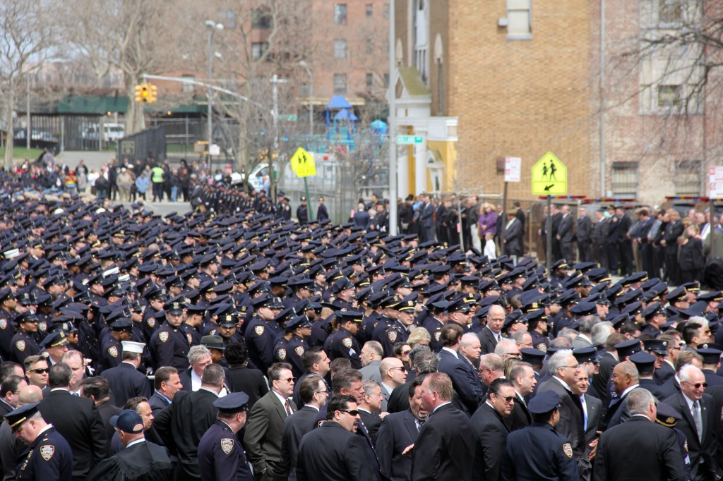 Members of the NYPD could be stretching out for blocks from the church. Photo by Richard York
