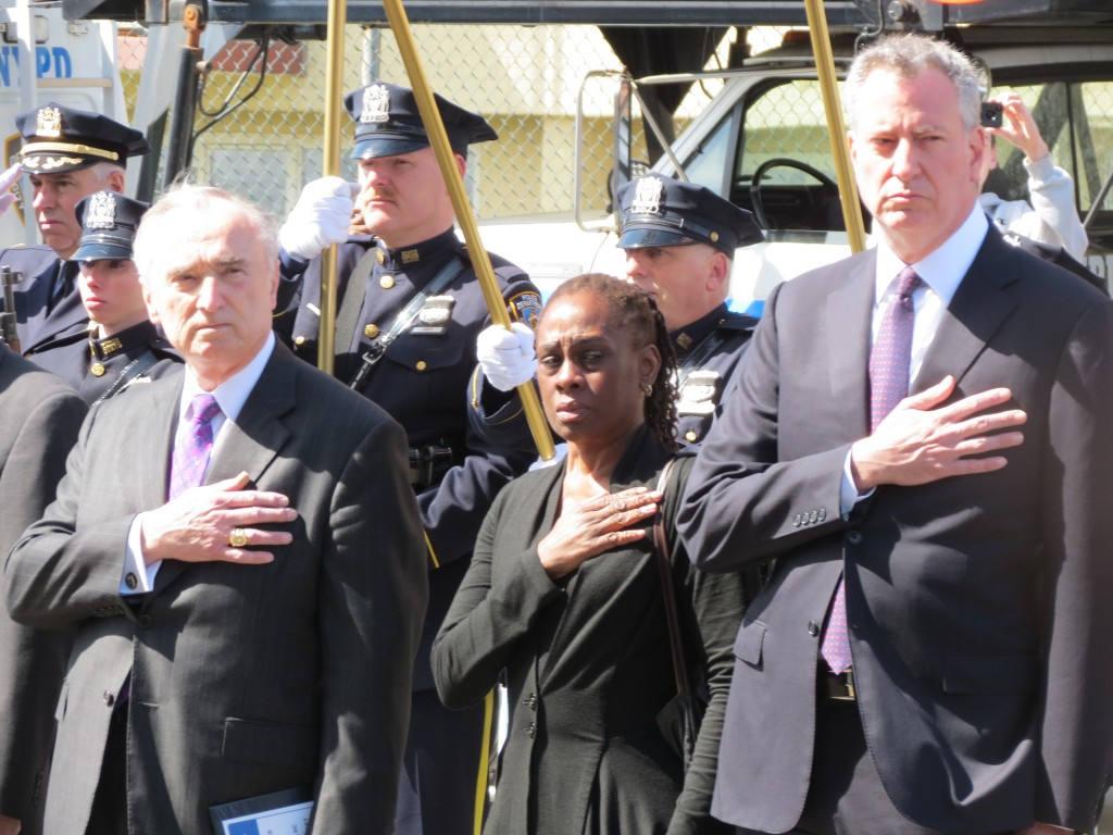 NYPD Commissioner William Bratton, left, Mayor Bill de Blasio's wife Chirlane McCray, and de Blasio outside the church. Photo by Anna Gustafson