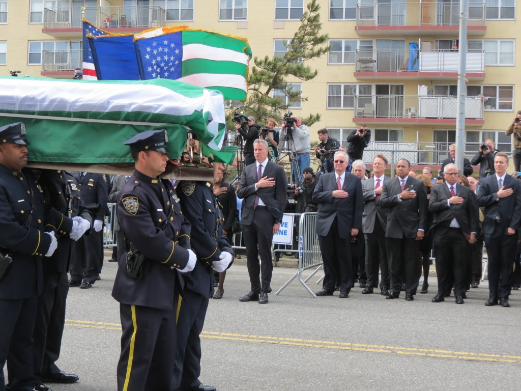 NYPD members carry the coffin of fallen Officer Dennis Guerra. Photo by Anna Gustafson