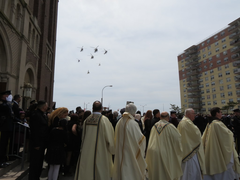 Helicopters perform a fly-by during the funeral procession. Photo by Anna Gustafson