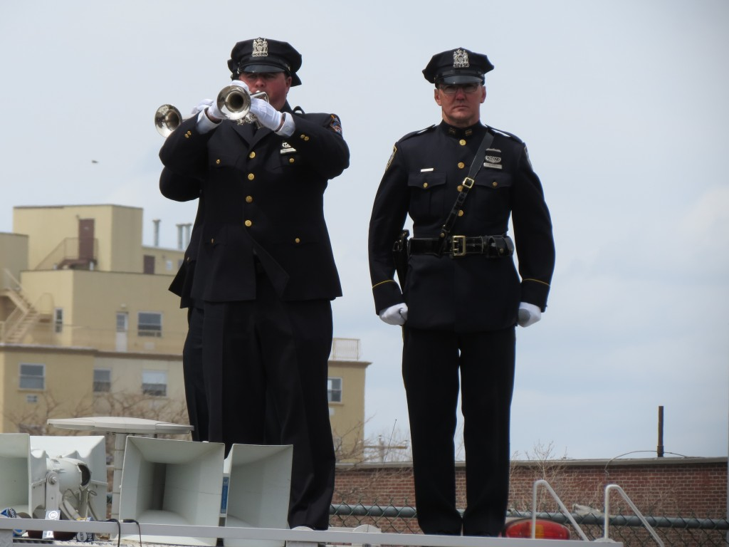 "Members of the NYPD play ""Taps."" Photo by Anna Gustafson"