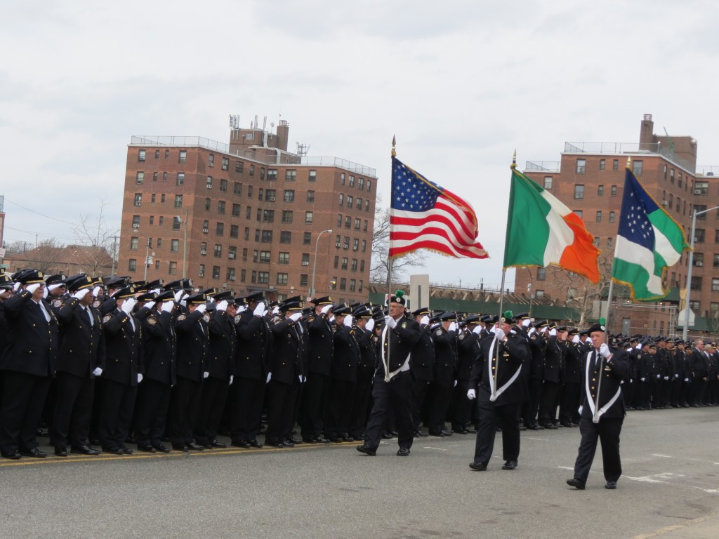 NYPD members salute at Officer Dennis Guerra's funeral.  Photo by Anna Gustafson
