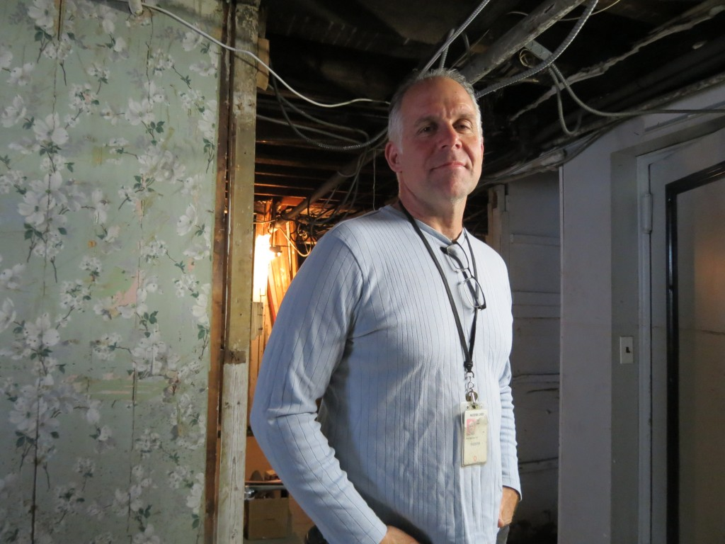 John Cori stands in the basement of his Rockaway Beach home that was devastated during Hurricane Sandy.  Photo by Anna Gustafson