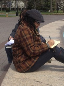 Poet Malini Singh McDonald spends time at the Unisphere last year - one of the sites selected to be part of Newtown Literary's Queens Writes spots. Photo courtesy Newtown Literary