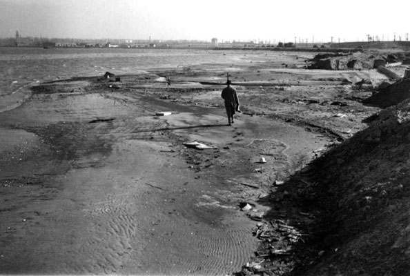 "In The Great Gatsby, F. Scott Fitzgerald described the area that would be become Flushing Meadows-Corona Park as ""a valley of ashes — a fantastic farm where ashes grow like wheat into ridges and hills and grotesque gardens."" This photo was taken in 1936, during the park's construction. Photo courtesy NYC Parks"