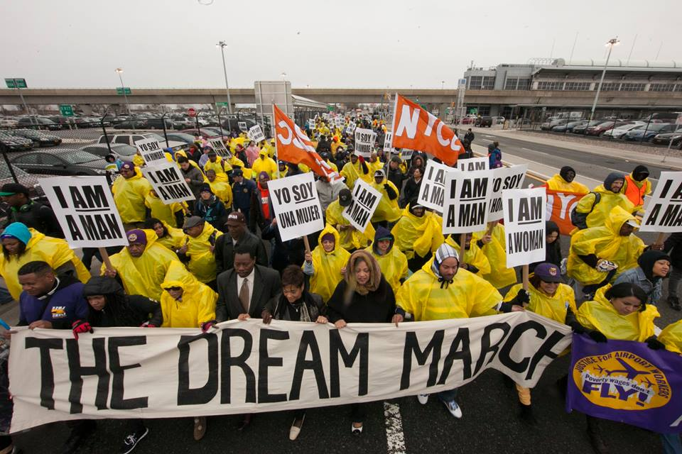 Elected officials, union leaders, and workers urged major airline companies to follow through on wage increases during a march Friday from JFK International Airport to LaGuardia Airport. Photo courtesy 32BJ SEIU