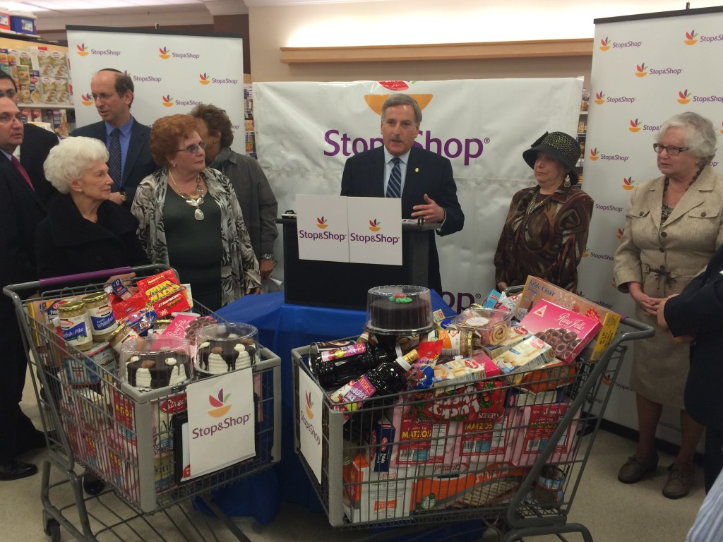 Assemblyman David Weprin, center, joins Councilwoman Karen Koslowitz, second from left, Queens Jewish Community Council Executive Director Cynthia Zalisky, second from right, state Sen. Toby Stavisky, right, and other community leaders to announce Stop and Shop's donation of 1,000 pounds of food for Passover. Photo courtesy NYS Assembly
