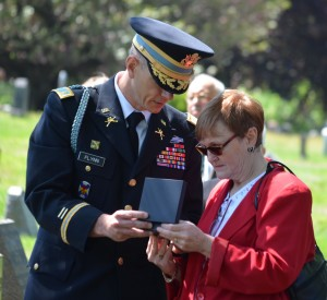 Diane Lowe is presented with two medals for her great-uncle, Private Charles T. Luginsland.  Photo by Caroline Roswell