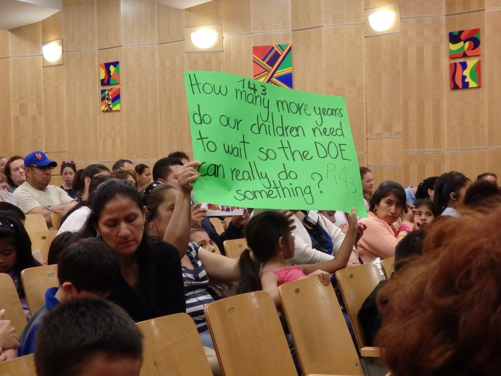 Parents frustrated with the notoriously overcrowded classrooms that have long plagued Queens attend a town hall meeting with schools Chancellor Carmen Farina in Ridgewood on Tuesday evening.  Photos by Phil Corso
