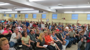 Hundreds of residents attended Tuesday night's Howard Beach-Lindenwood Civic Association meeting to air concerns about the recent flooding that devastated homes and drove people from their houses.  Photos by Anna Gustafson
