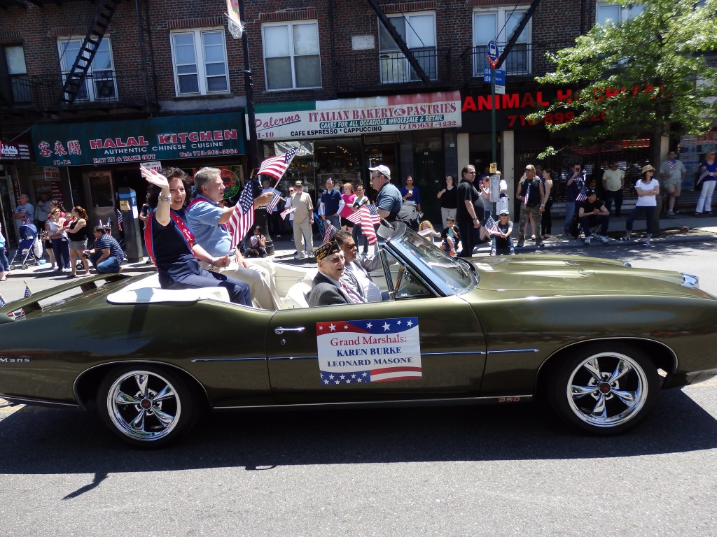 Karen Burke (l.) and Leonard Masone (second from l.) led the way at Maspeth's Memorial Day Parade as grand marshals. Photo by Phil Corso