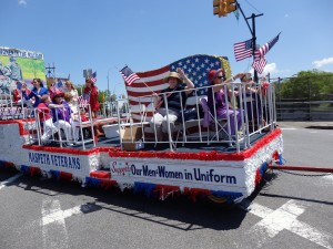 "A parade float drives home the theme of this year's Memorial Day Parade in Maspeth, ""Women in the Military.""  Photo by Phil Corso"