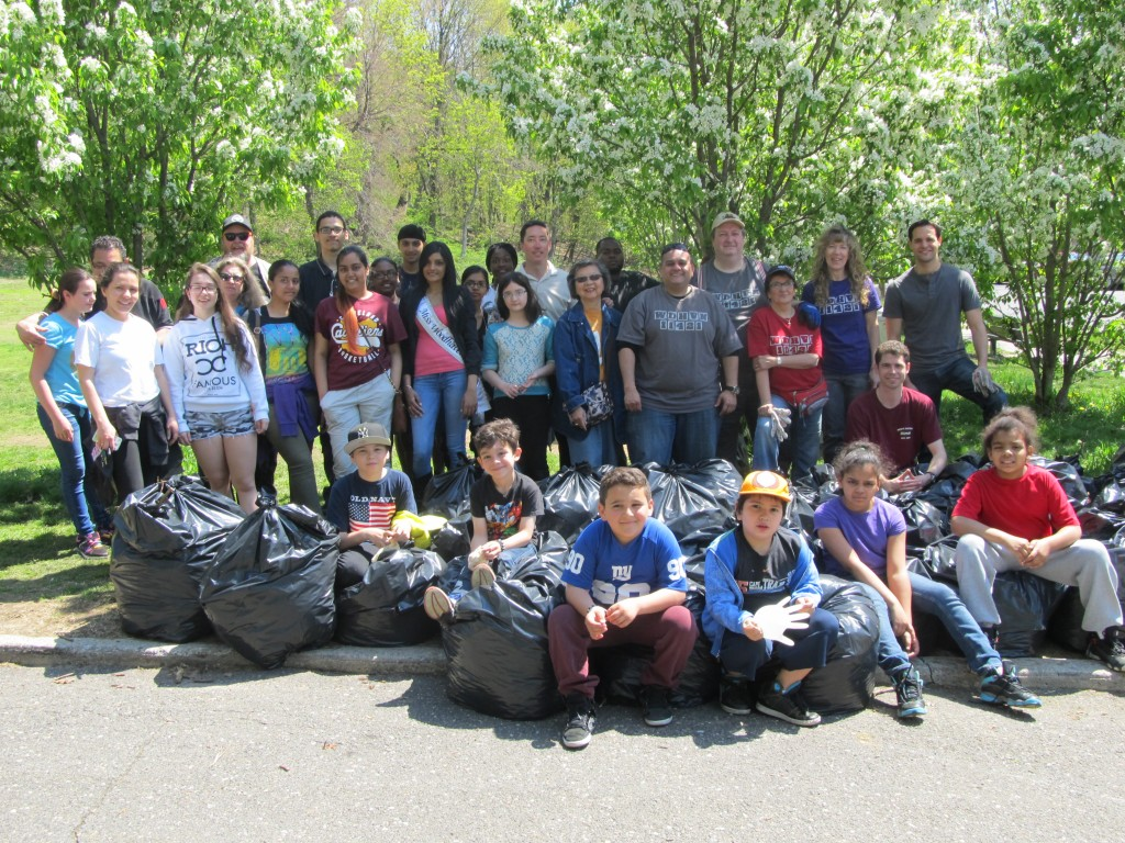 Volunteers gather with some of the bags of leaves and debris they had collected.  Photo courtesy Josephine Wendell