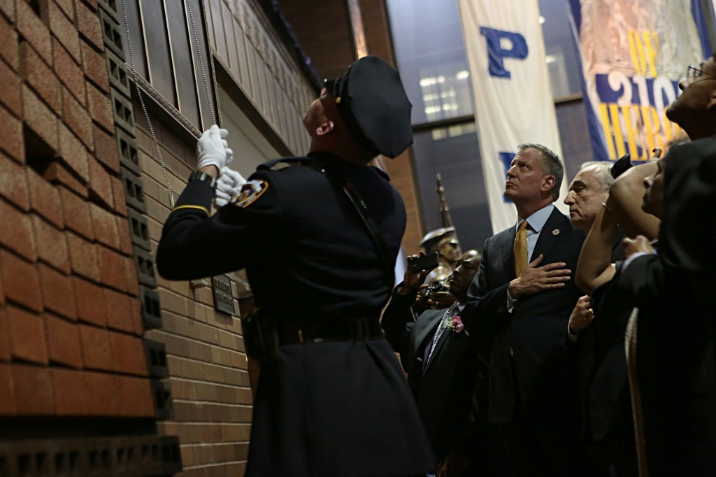 Police officers and city leaders, including NYPD Commissioner Bill Bratton and Mayor Bill de Blasio, attended a ceremony at One Police Plaza last week, when 13 names of fallen NYPD members were added to a memorial wall.  Photo by Ed Reed/NYC Mayor's Office