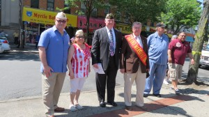 Samuel Mantilla, left, of the Queens Chapter of Disabled American Veterans; Nancy Rivera, the New York State Disabled Veterans of America chapter commander; parade commander Dan Wisotsky; and Grand Marshal Charles Dunn gather at the Ridgewood Veterans Triangle for Monday's opening ceremonies.  Photo by Anna Gustafson