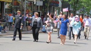 Retired U.S. Army Major General Evo Riguzzi, left, Assemblywoman Cathy Nolan, Councilwoman Elizabeth Crowley, and U.S. Rep. Grace Meng march down Myrtle Avenue.   Photo by Anna Gustafson