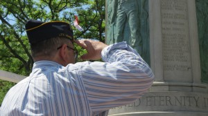 A veteran salutes the Ridgewood War Memorial during the parade's opening ceremony.  Photo by Anna Gustafson