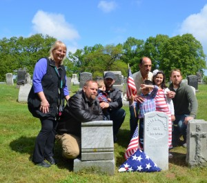Sean Walsh and his family with the headstone of Pvt. Charles Louis Haniquet , Walsh's third great-grandfather.