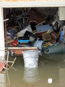 When residents assessed the damage in their homes following the storm, many were faced with destroyed garages and basements.  Photo by Robert Stridiron