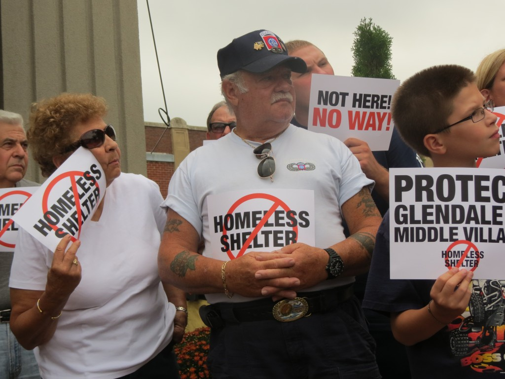 Residents and civic leaders gathered for a protest against the proposed homeless shelter last summer.  File Photo