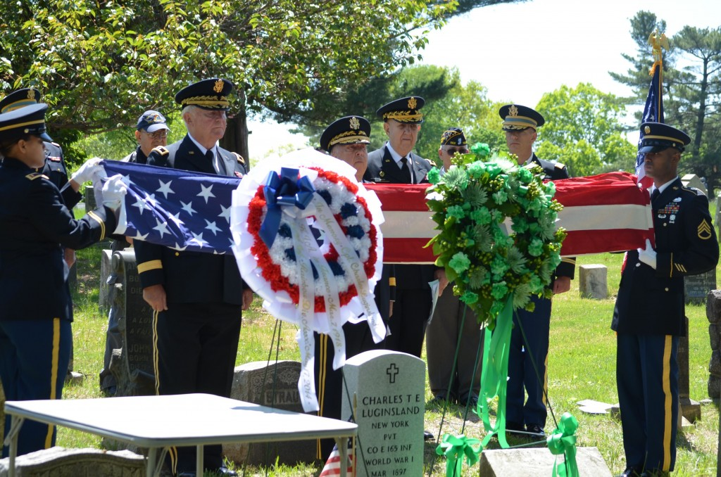A military burial ceremony was held at the Evergreens Cemetery for Private Charles T. Luginsland, who was killed during World War I when the bunker he, and 21 others in his unit, was bombed on March 7, 1918. Originally buried in France, Private Luginsland had been moved to the Evergreens Cemetery, but his name was worn off his grave by the elements long ago. A new headstone has been placed for the man who died just four days short of his 21st birthday.   photos by Caroline Roswell