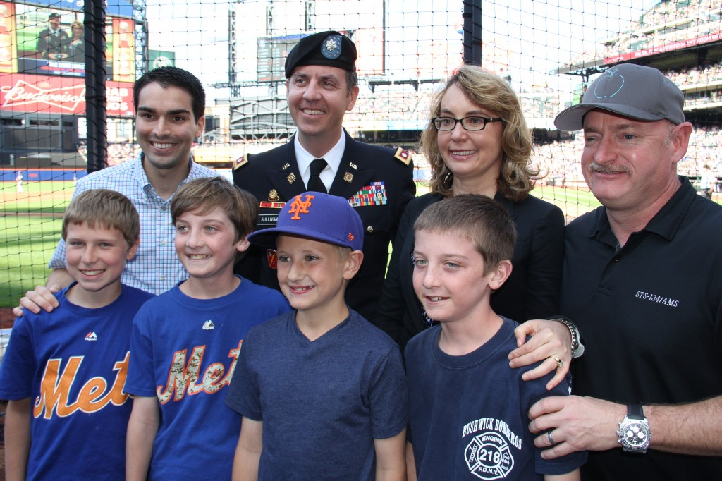 Councilman Eric Ulrich, left, Lt. Col. Thomas Sullivan, former U.S. Rep. Gabby Giffords, and Capt. Mark Kelly at Citi Field during a ceremony honoring Sullivan, a Breezy Point resident who has served two tours in Iraq.  Photo courtesy Councilman Eric Ulrich's Office