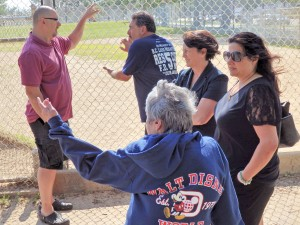 Residents discuss issues at the park, including littering and overgrown grass.  Photo by Phil Corso