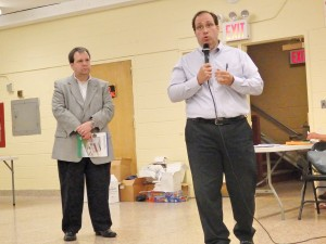 DEP reps Mario Bruno (l.) and Vincent Sapienza tell Lindenwood about the agency's preliminary report filed with the city comptroller's office.  Photo by Phil Corso