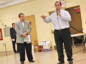Vincent Sapienza (r.) and Mario Bruno of the DEP outline the failures that led to flooding during the April 30 rainfall in southern Queens.  Photo by Phil Corso