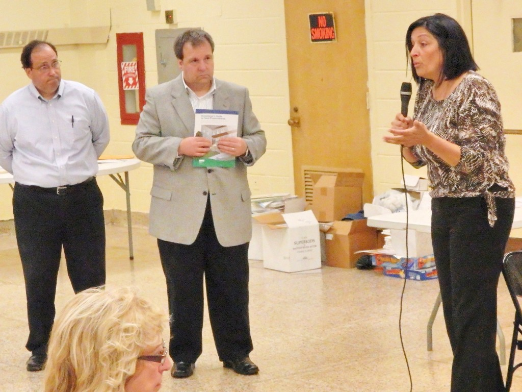 Howard Beach-Lindenwood Civic President Joann Ariola (r.) argues that DEP reps were not helpful in their visit to the group's Tuesday meeting. Photo by Phil Corso