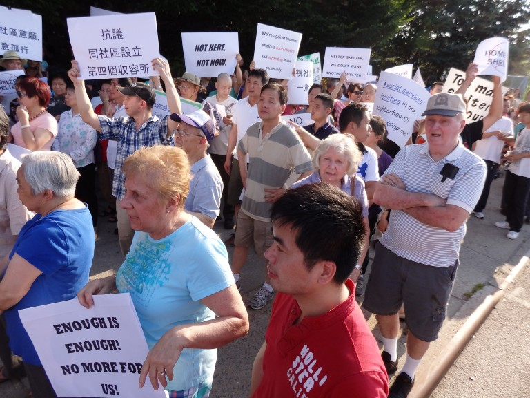 Massive Crowd Protests Homeless Shelter in Elmhurst's Pan Am Building