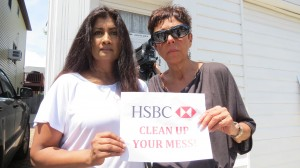 Neponsit residents Sherry Calamia, left, and Joyce Zoller are calling on HSBC to clean up the house next to them, which they said has become a haven for mold and has caused them serious health problems.  Photo by Anna Gustafson