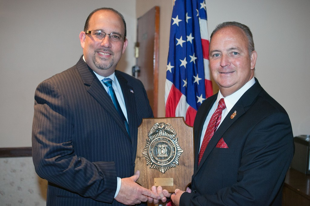 New York City Fire Marshals Benevolent Association President William Kregler, right, presents a plaque to Dmytro Fedkowskyj to commemorate the association's endorsement of Fedkowskyj for State Assemblyman.  Photo courtesy Dmytro Fedkowskyj